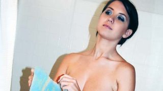 Cute beautiful Chrissy masturbates with a shower